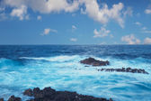 Rocky coastal inlet with breaking waves — Stock Photo