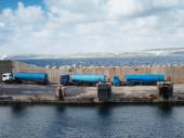 Tankers lined up on a cement wharf — Stock Photo