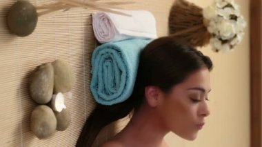 Beautiful brunette girl is pampered at the health spa waiting for her massage — Stock Video