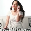 Young Female Mixing Music Using DJ Mixer — Stock Video #65377381