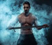 Gorgeous Shirtless Muscled Man Holding a Sword — Stock Photo