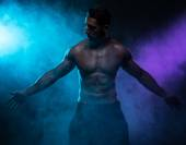 Silhouette Shirtless Muscled Man Posing in Smoke — Stock Photo