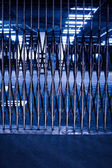 Security Fence in Parking Garage at Night — Stock Photo