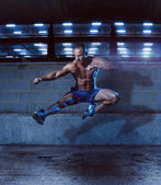 Athletic Man in Fighting Pose Inside a Building — Stock Photo