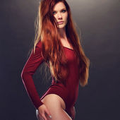 Seductive Woman Posing in Red Long Sleeved Leotard — Stock Photo