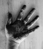 Left hand of a man dirty of charcoal — Stock Photo