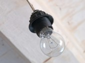 Incandescence lamp on a white ceiling background. — Stock Photo