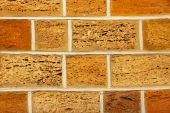Yellow and orange shell limestone brick wall as abstract backgro — Foto de Stock