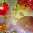 Eve of new year.Clock face and multicolored glitter balls. — Stock Photo #59719891