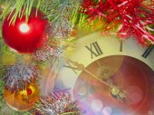 Eve of new year.Clock face and multicolored glitter balls. — Stok fotoğraf