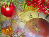Eve of new year.Clock face and multicolored glitter balls. — Stockfoto