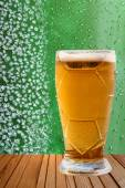 Frost beer glass against of ice crystals and drips green backgro — Stock Photo