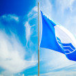 Blue Flag on Beautiful Sky Background — Stock Photo #63289913