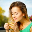 Young Woman Drinking Green Tea Outdoors — Stock Photo #63518585