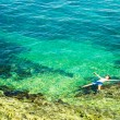 Man Floating in Crystal Clear Sea — Stok fotoğraf #63827079