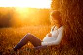 Young Pregnant Woman Sitting by the Haystack — Foto de Stock