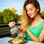 Young Woman Making Green Tea Outdoors — Stock Photo #66087939