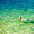 Man Swiming in Crystal Clear Sea — Stock Photo #68018325