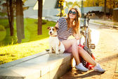 Smiling Hipster Girl with her Dog and Bike — Stok fotoğraf
