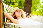 Happy Woman Relaxing in a Hammock — Stock Photo