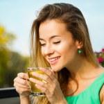 Happy Woman Drinking Green Tea Outdoors — Stock Photo #71220221