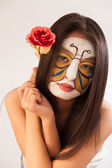 Girl with butterfly painted on face — Stock Photo