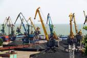 Seaport with cranes and coal — Stock Photo