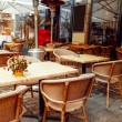 Street view of a coffee terrace with tables and chairs — Stock Photo #54893365