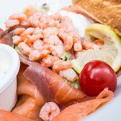 Seafood salad with smoked salmon — Stock Photo