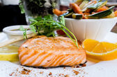 Grilled salmon and lemon — Stock Photo