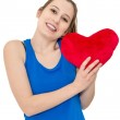 Young woman holding a red heart — Stock Photo #60148431