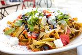 Spaghetti with aubergine and tomato — Stock Photo