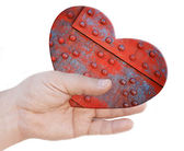 Iron heart in hand — Stock Photo