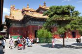 Tourists walking about Yonghegong Lama Temple — Stock Photo