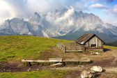 Morning view from Sexten Dolomites with chalet — Stock Photo