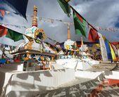 Prayer flags with stupas - Kunzum La pass - Himachal Pradesh - India  — Stock Photo
