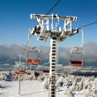 Chair lift on Mount Serak for downhill skiers — Stock Photo #63655681