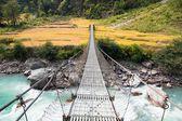 Rope hanging suspension bridge in Nepal — Stock Photo