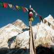Evening view of Mount Everest with buddhist prayer flags — Stock Photo #64297217
