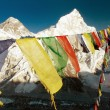 Evening view of Mount Everest with buddhist prayer flags — Stock Photo #66209611