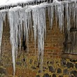 Icicles on a rain gutter — Stock Photo #65832199