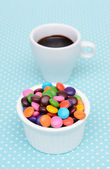Hot chocolate and colorful candy — Stock Photo