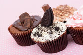 Chocolate Strawberry Cookies and cream cup cake on vintage pink table cloth — Stok fotoğraf