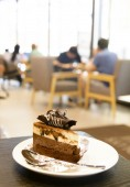 Chocolate cake in a cafe — Stock Photo