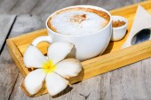 Cappuccino coffee on old wooden table — Foto de Stock
