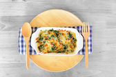 Baked spinach with cheese — Stock Photo