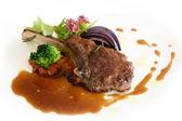 Roast lamb chops with gravy on white background — Stock Photo
