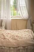 Feminine bedroom with bed — Stock Photo