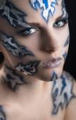 Woman with silver face-art — Stock Photo