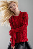 Girl in red sweater and black skirt — Stock Photo